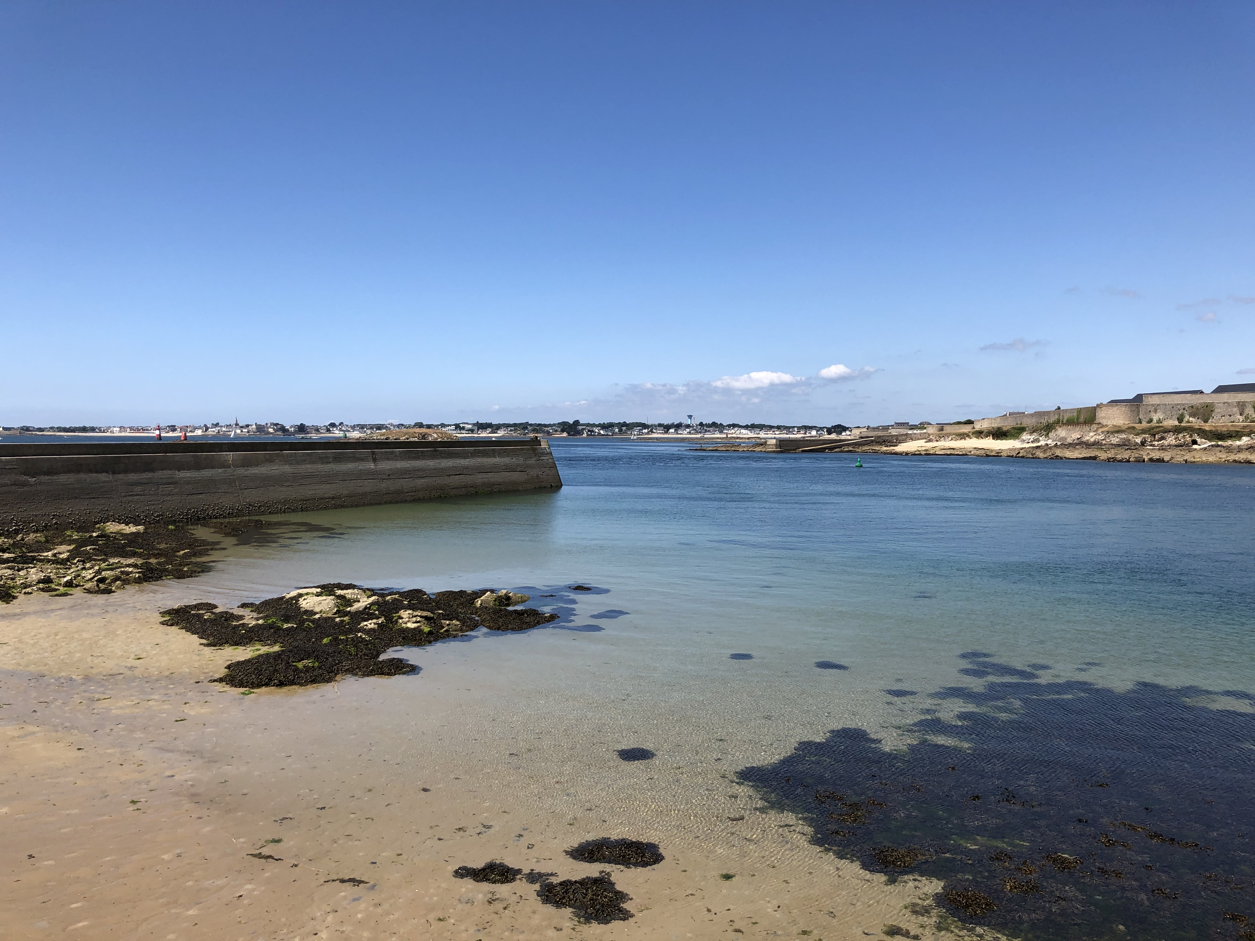 Clear blue sea and sky with a sandy beach at Gâvres in France