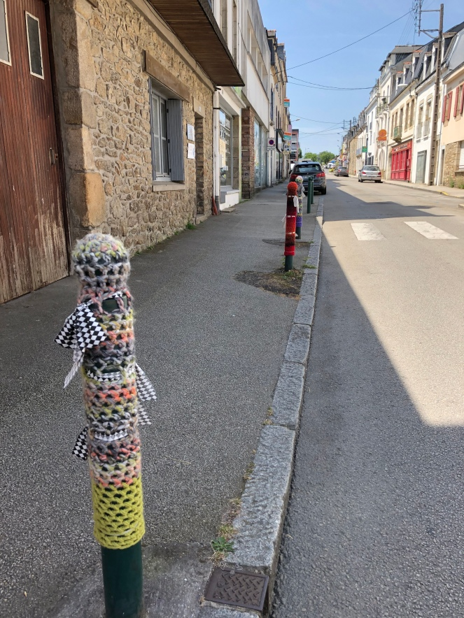 Knit or crochet bollard coverings on the kerb